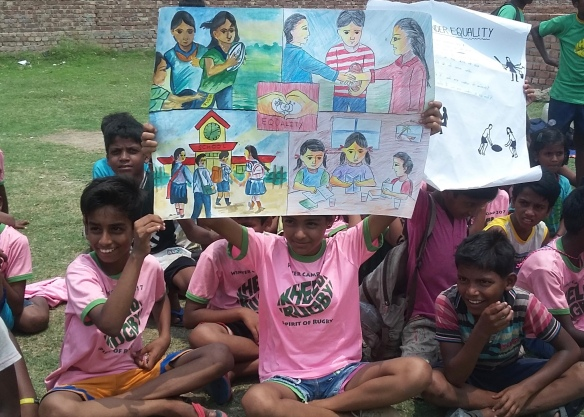Children displaying their creative posters